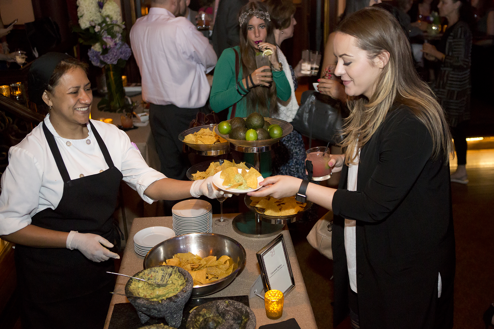 Attendants serving patrons at the homemade guacamole station
