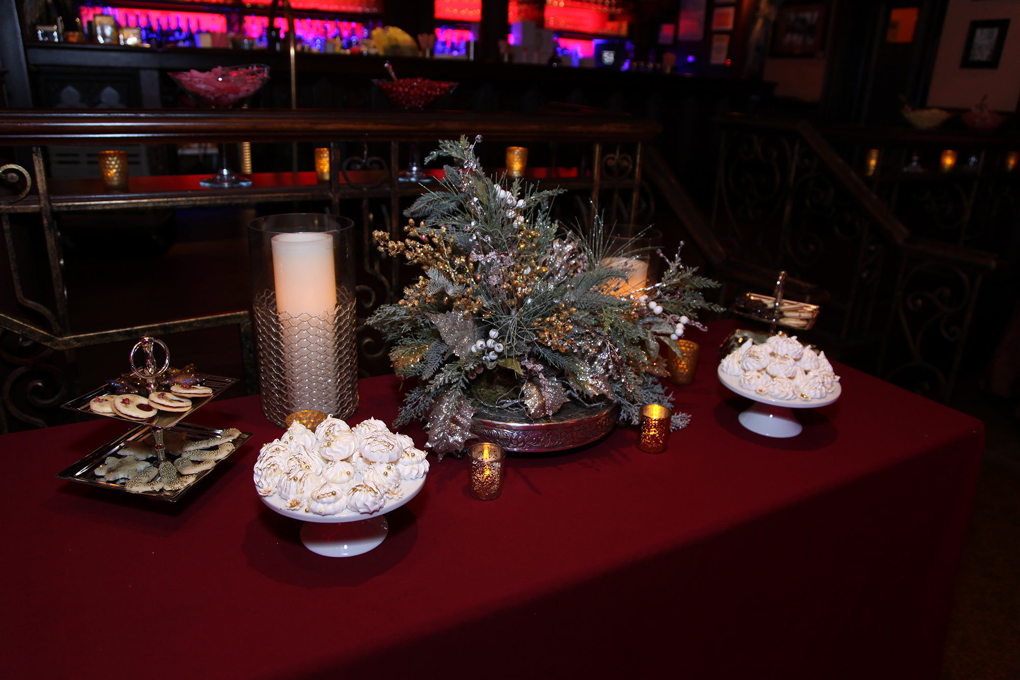 Holiday dessert station with leafy centerpiece