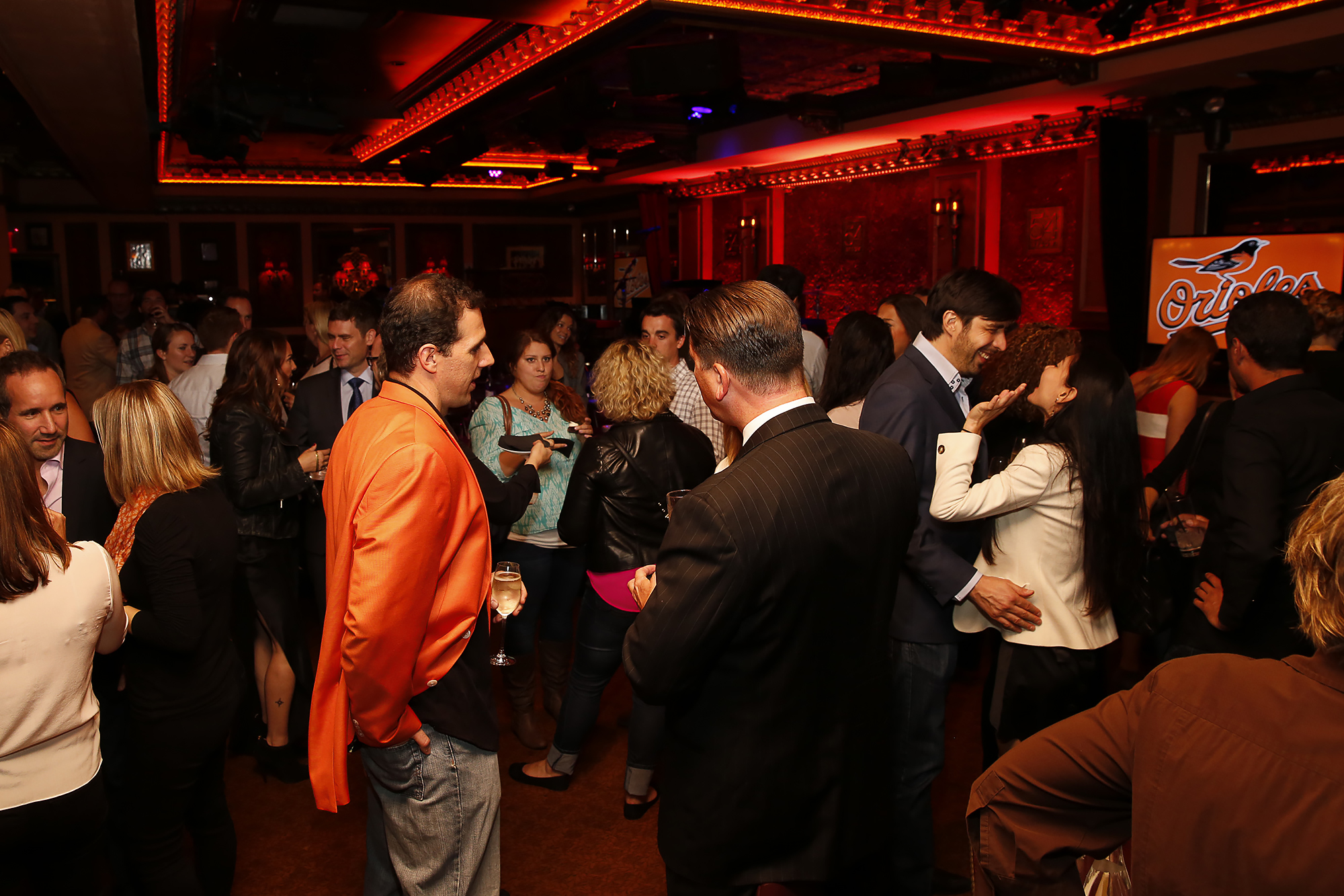 People mingle in the dining room at Baltimore Orioles event